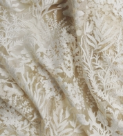 White embroidery on beige tulle lace