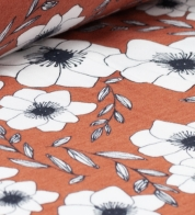 Digiprint cotton jersey flowers on brown