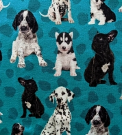 Digiprint cotton jersey puppies on green on